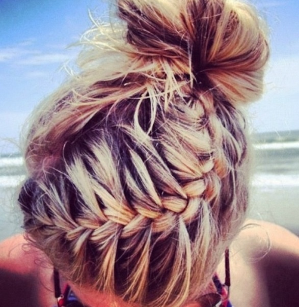 Combine a bun with a braid and call it a day, this look is awesome!